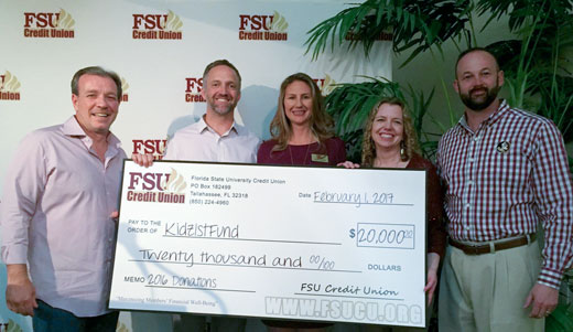 FSUCU presents check