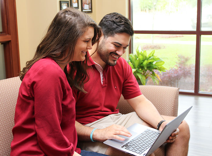 Couple reviewing bank accounts online