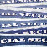 Social Security cards artfully stacked.
