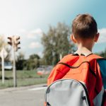 Boy with Orange Backpack Crossing Street