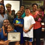 Jahkkari Foster and Family with Employee of the Quarter award